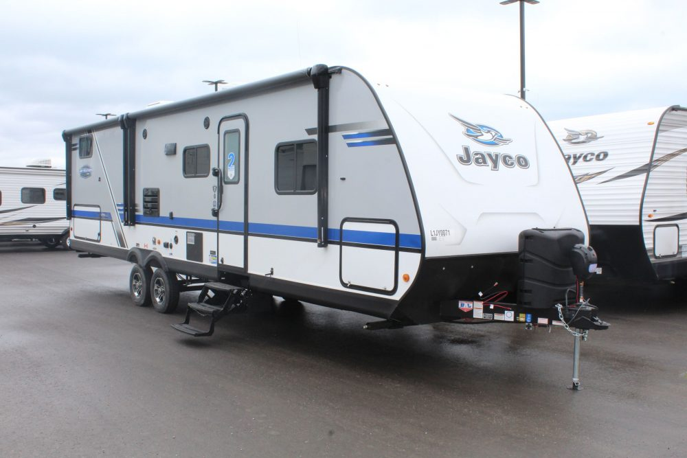 The Front and Right side of the Jayco Jay Feather 29QB, comes with not only a 16' Awning, but it also has a 10' awning, both awnings are powered and come with LED lighting.