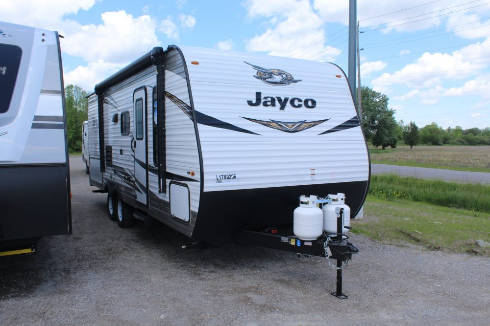 Front and right exterior sides of the Jayco Jay Flight SLX 224BH, with its 13' Power awning with LED lights & speakers, and Keyed-Alike™ entry and baggage doors.