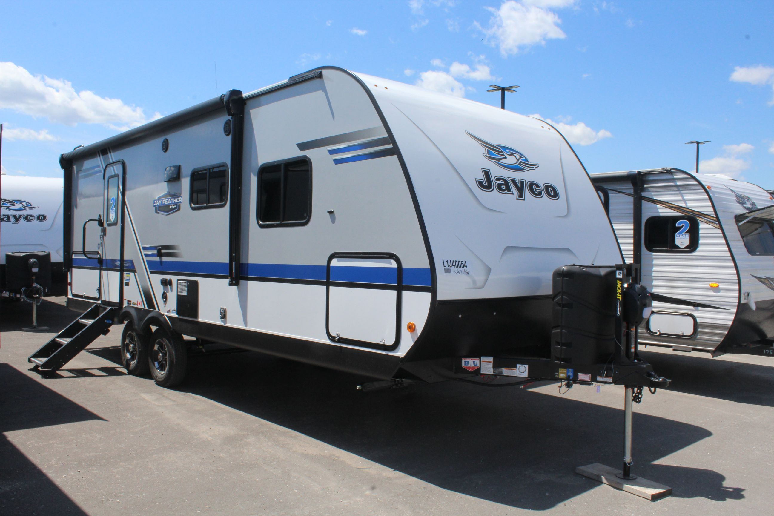 Front and Exterior sides of the Jayco Jay Feather 22RB, with its 16' Power awning with LED lights, and Outside camp kitchen.