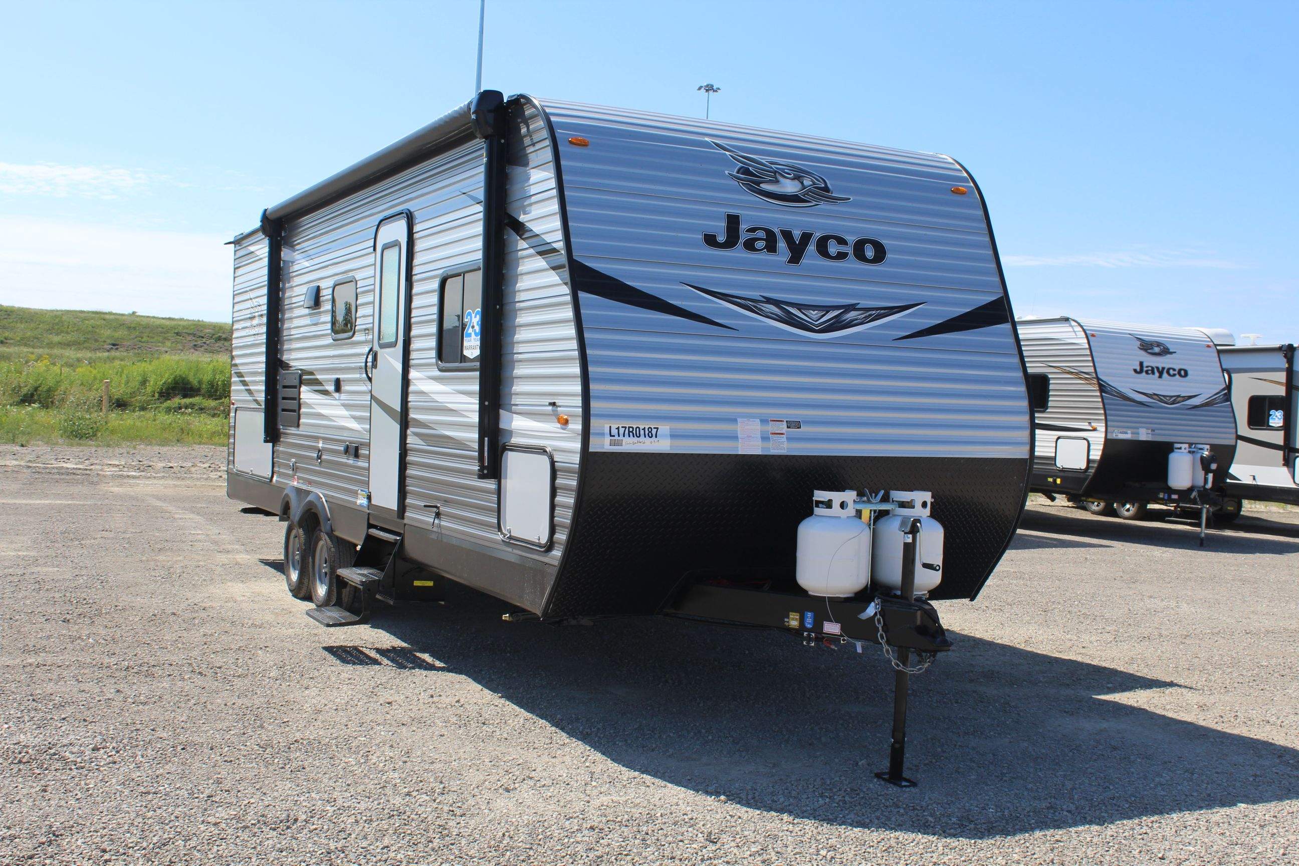 Front and Right side of the Jay Flight SLX 242BHS, with its 18' Power awning with LED lights & speakers.