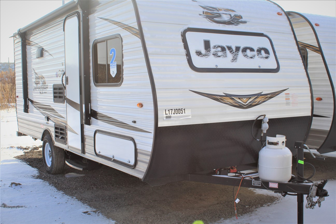 The Front and Right of the Jayco Jay Flight 174BH, withs its 10' Power awning with LED lights & speakers, and Keyed-Alike™ entry and baggage doors.
