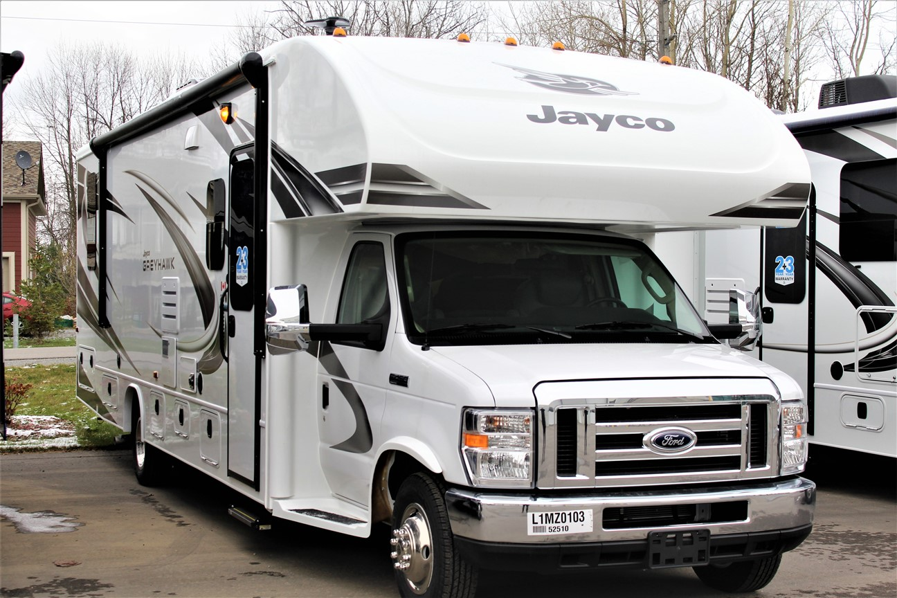 The front and Right exterior sides of the Jayco Greyhawk 30Z, with its 16' Awning.