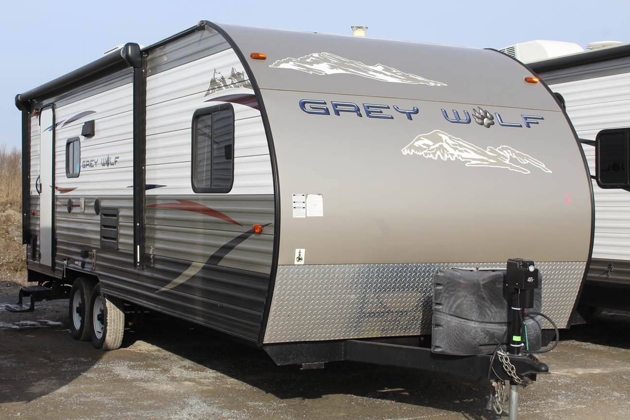 Right and front sides of the Forest River Grey Wolf 21RR, with its 15ft Awning.