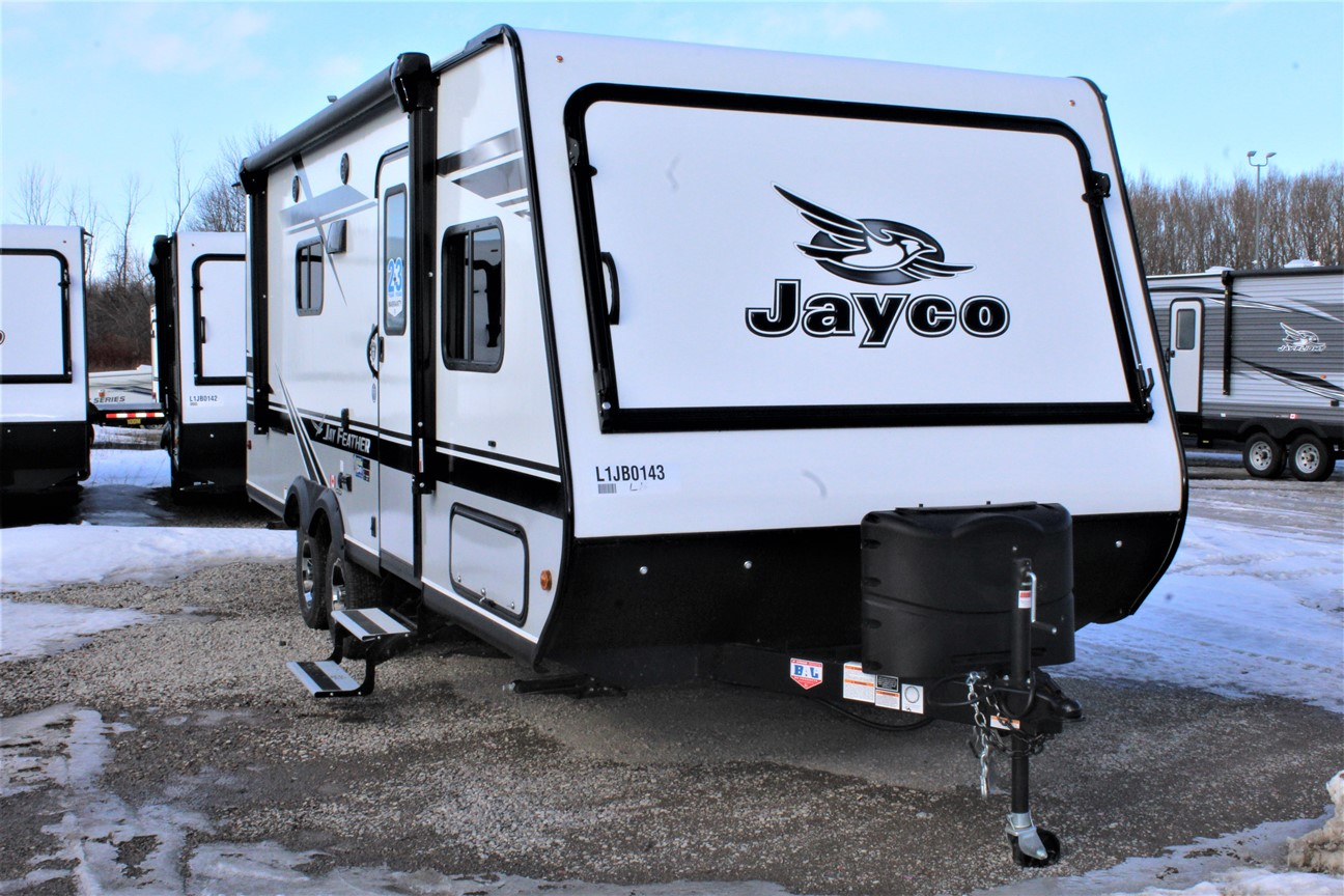 The Front and Right side of the Jayco Jay Feather X23B, with its 13' Power awning with LED lights , and its 2 20 lb. propane bottles with auto regulator.