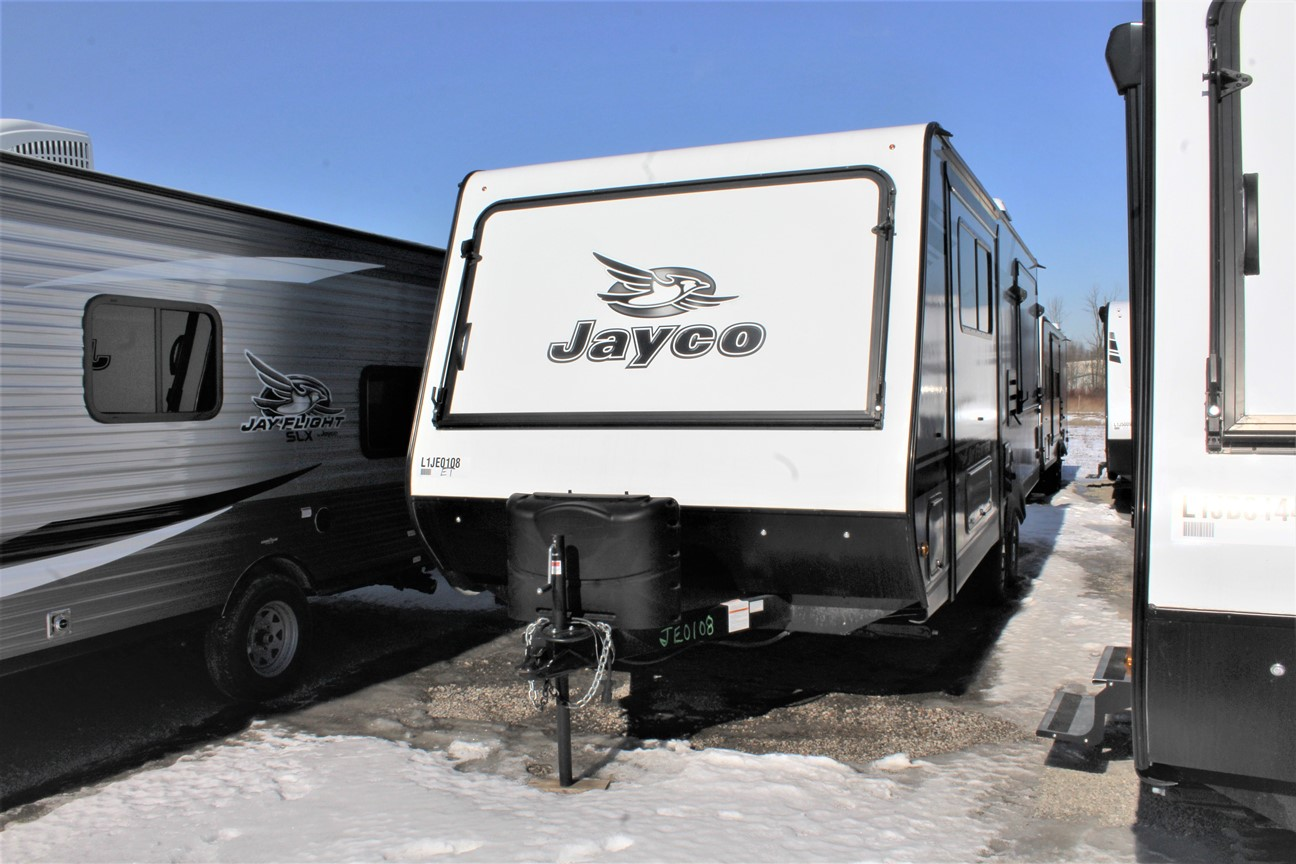 Front and Left Exterior View of the Jayco Jay Feather X23E Hybrid Trailer with its Slideouts with double seals, barrier sponges, and U-channel drip spout. Along with its Water-repellent, scratch resistant Jayco DuraTek™ vinyl tent material with zipper windows.