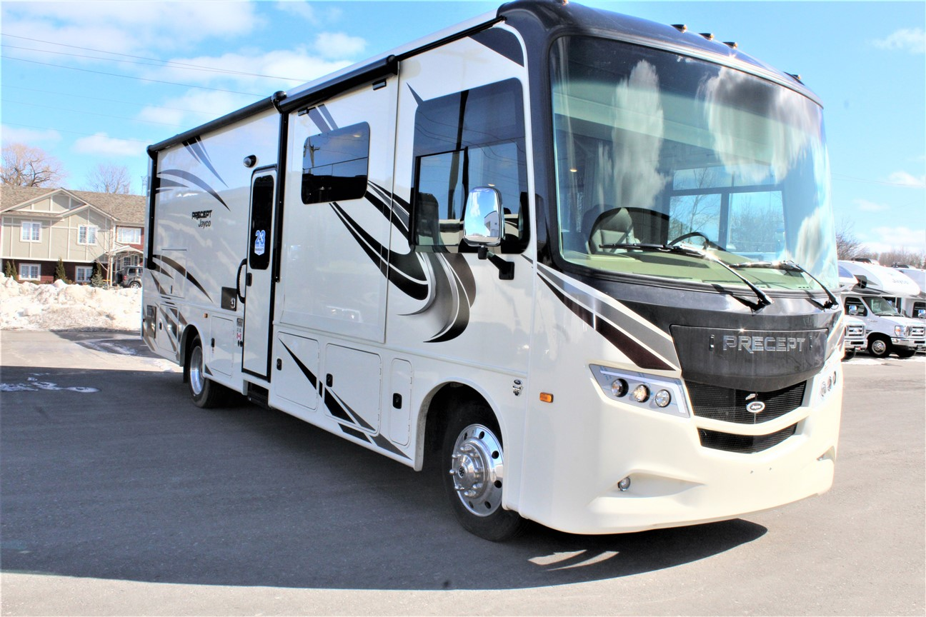 Front and right side of the Jayco Precept 31UL, with its 16' Electric patio awning with LED lights, and Exterior entertainment center with LED TV mounted on swivel bracket and single-disc DVD/FM radio.