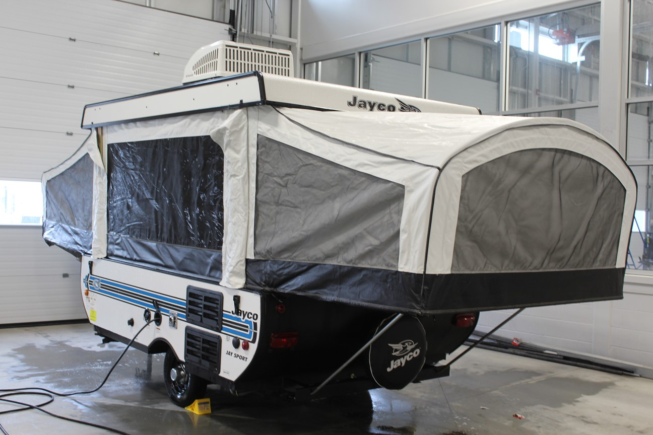 Rear and Left exterior sides of Jayco Jay Sport 10SD, with its Easy-to-use lifter system with wide lifter posts integrated into tent, and DuraTek water-repellent sectionalized tent.