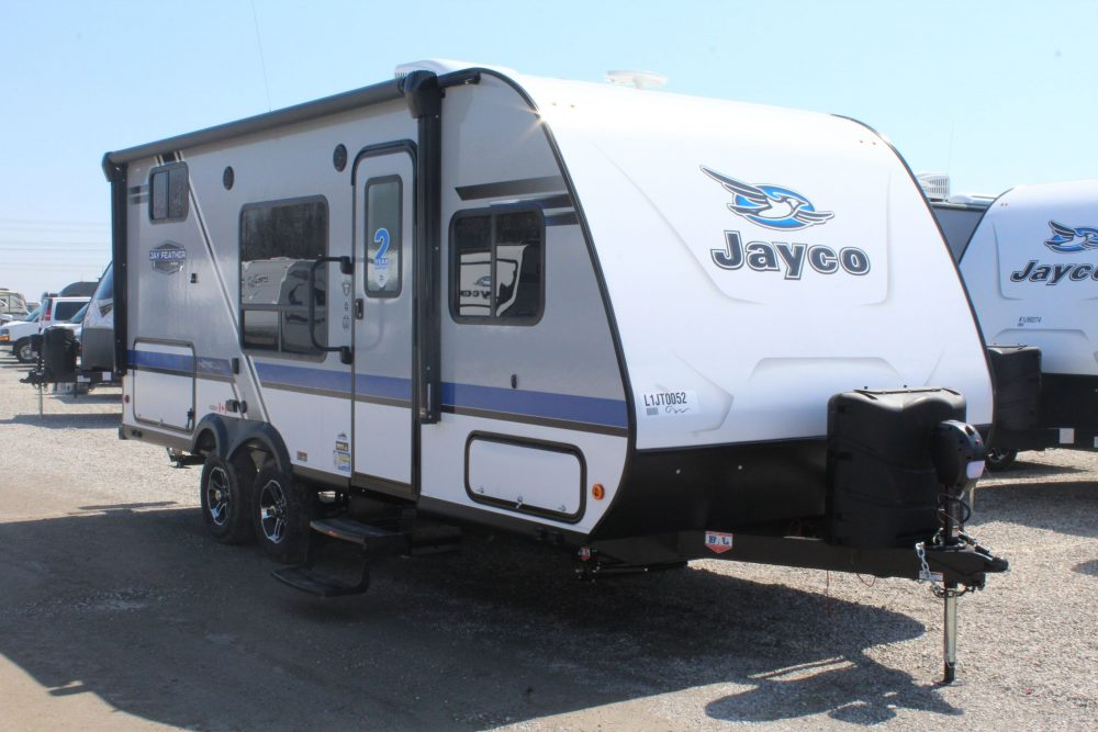 Front and right exterior sides of the Jayco Jay Feather 20BH, with its 15' power awning to cover outside camp kitchen with LED lights.